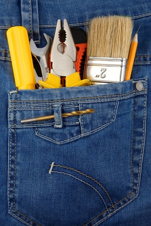 tools and instruments in blue jeans pocket photo