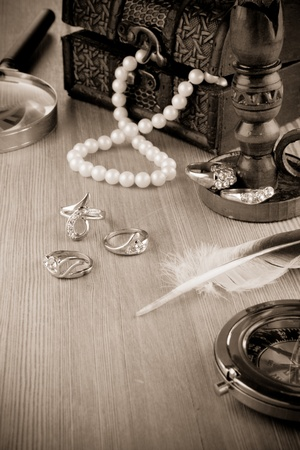 jeweller: old fashioned image of jewels on sepia Stock Photo