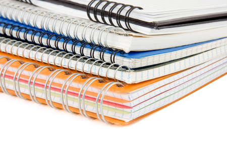 pile of checked notebook isolated on white background photo