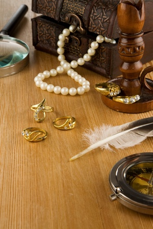 image of old fashioned jewels and feather photo