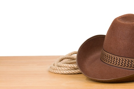 stetson: brown cowboy hat and rope isolated on white background