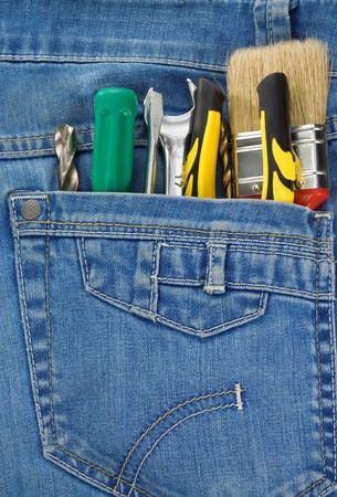 set of tools and instruments in jeans pocket background photo