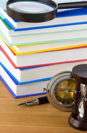 pile of books on wood background photo