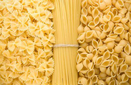 set of raw pasta as background photo