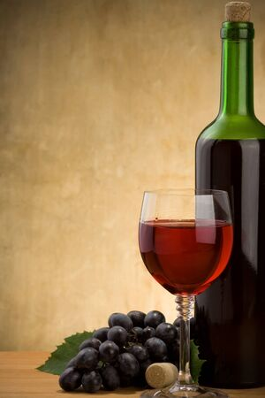 red wine in glass and bottle on wood background Stock Photo - 12311605