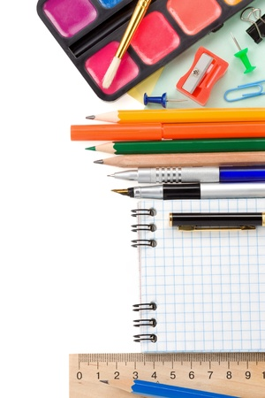 school accessories and checked notebook isolated on white background photo