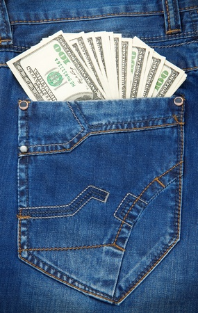 cash back: jeans pocket texture background and dollars