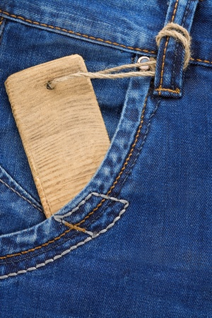 empty pocket: blue jeans texture pocket and price tag Stock Photo