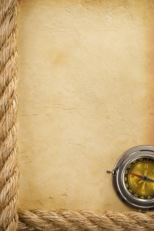 ropes and compass over old ancient paper background texture photo