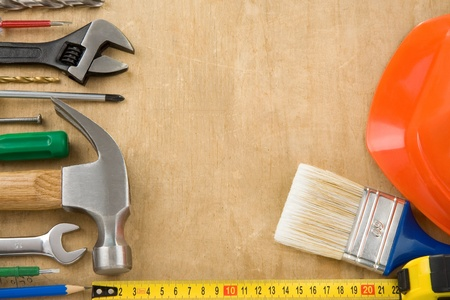set of tools on wood background texture Stock Photo - 12311452