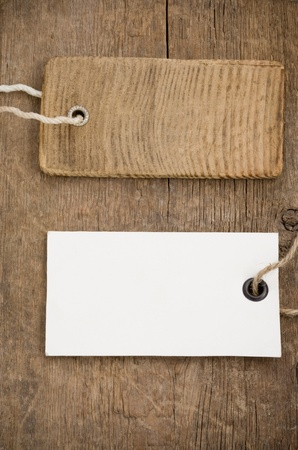 price tag over wooden board background Stock Photo - 12311476