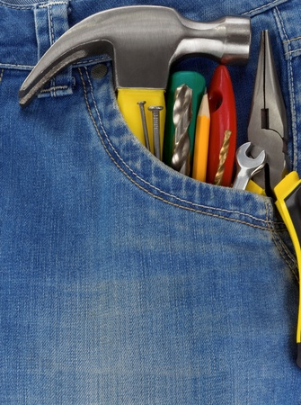 set of tools and instruments in blue jeans pocket photo