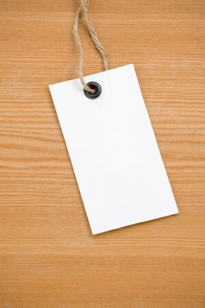 price tag on wooden board background photo