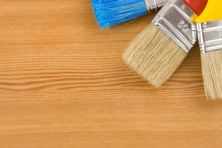 colorful paintbrush on wood background texture Stock Photo - 12311313