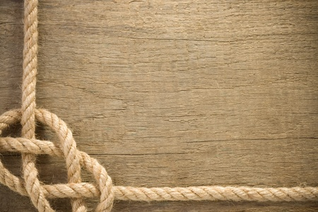 ship ropes with knot on wood background texture Imagens