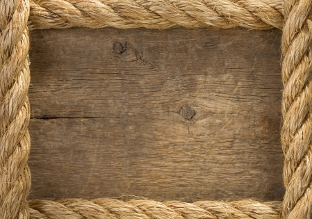 rope background: ship ropes borders on wood background texture Stock Photo