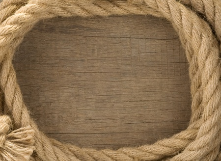 ship ropes and knot on wood background texture Stock Photo - 12311364