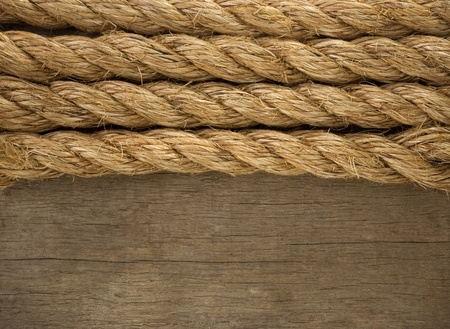 gibbet: ship ropes borders on wood background texture Stock Photo
