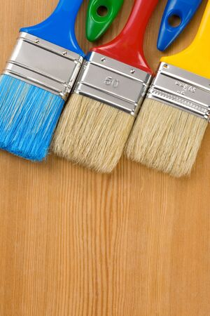 colorful paintbrush on wood background texture Stock Photo - 12311331