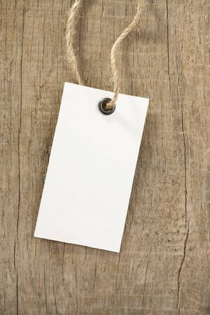 paper tags: price tag on wooden background