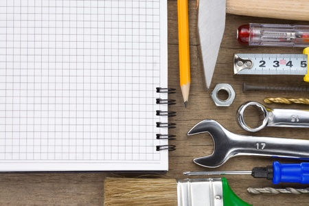 set of tools and notebook on wood texture background Stock Photo - 12311394