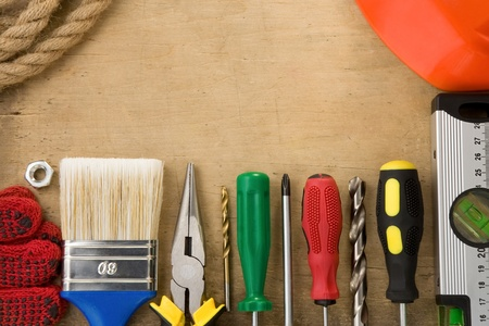 construction tools on wood background texture Stock Photo - 12311370
