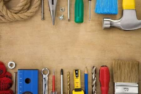 set of tools on wood texture background photo