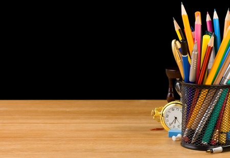 pen holder: basket holder and school supplies isolated on black background Stock Photo