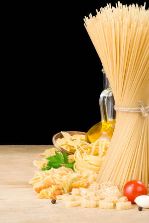 raw pasta and food vegetable isolated at black background photo