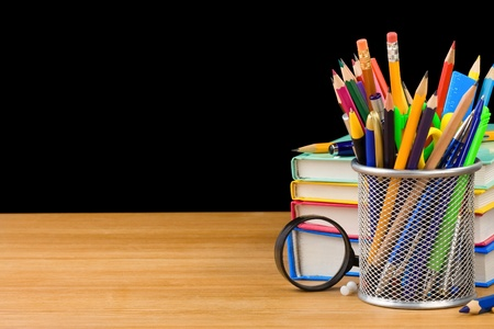 back to school concept and pile of books isolated on black background photo