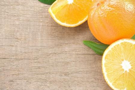 orange slices fruit on white wood background photo