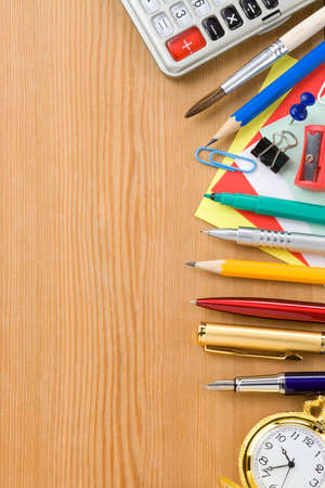 back to school concept and supplies on wood background photo
