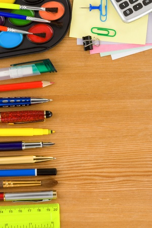 school life: back to school concept and supplies on wood background