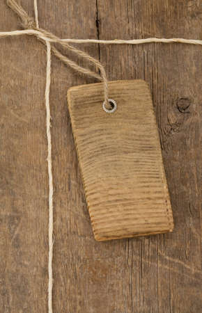 price tag over wooden board background photo