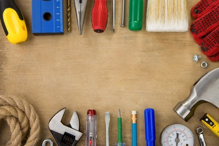 set of tools and instruments on wood texture background photo