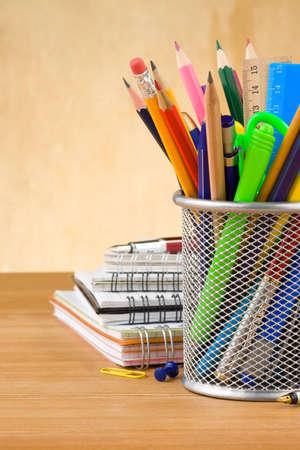 pen holder: back to school concept on wood background