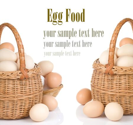 eggs and basket isolated on white background photo