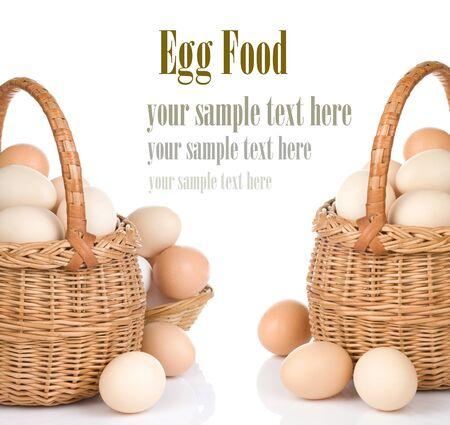 eggs and basket isolated on white background photo