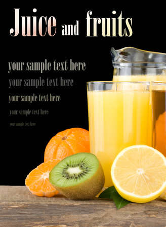 fresh fruits juice in glass and slices isolated on black background photo