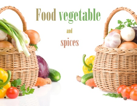 fresh vegetables and green leaves in basket isolated on white background photo