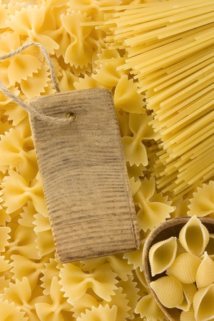raw pasta and price tag as background photo