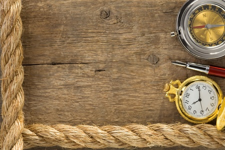 gibbet: ship ropes and compass with pen on old vintage wooden background Stock Photo