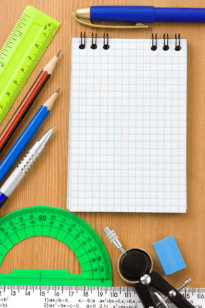 back to school and supplies on wood background photo