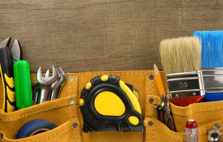 tools in construction belt on wooden background texture Stock Photo - 12411131