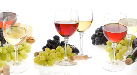 wine in glass and fruit isolated on white background photo
