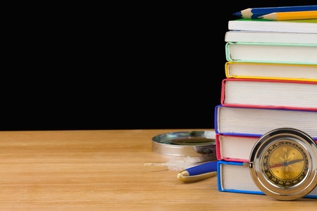 back to school supplies and books isolated on black background texture photo