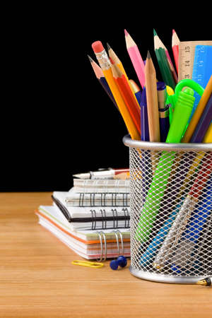 back to school concept and office supplies isolated on black background photo