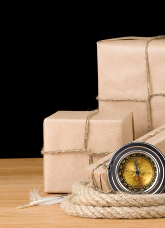 parcel wrapped packaged box isolated on black background photo