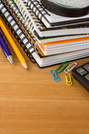notebooks and pens on wood background texture photo