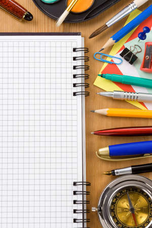 back to school concept and office supplies on wood photo